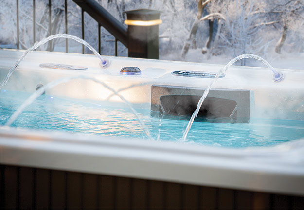 A Michael Phelps Signature Series Swim Spa stays warm despite the open winter air with a variety of insulation features.