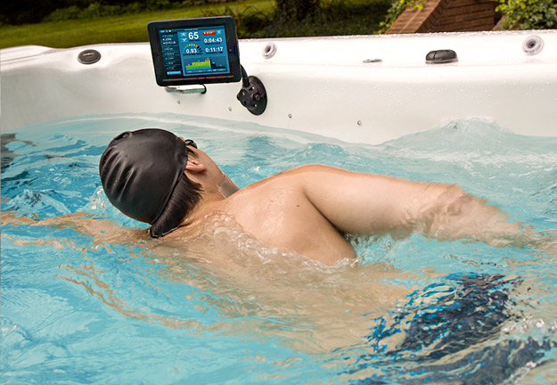 A swimmer monitors his workout with the SwimNumber iPad App.