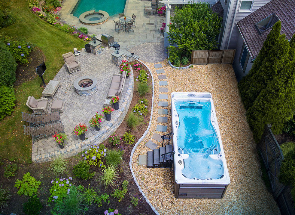 Create a backyard oasis with a michael phelps swim spa momentum deep