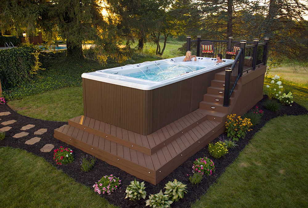 Backyard ideas for your michael phelps swim spa for Backyard patio landscaping ideas