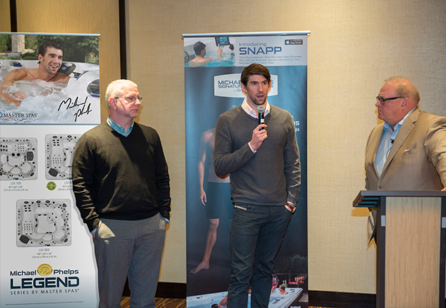 Michael Phelps and Bob Bowman speaking with Master Spa Dealers